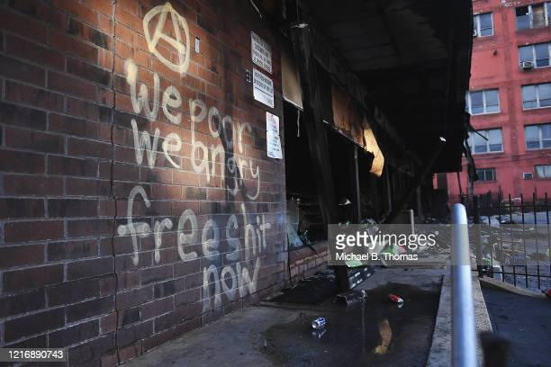 Graffiti is seen on a burned out 7Eleven after riots and looting overnight on June 2 2020 in St Louis Missouri Four police officers were reportedly...