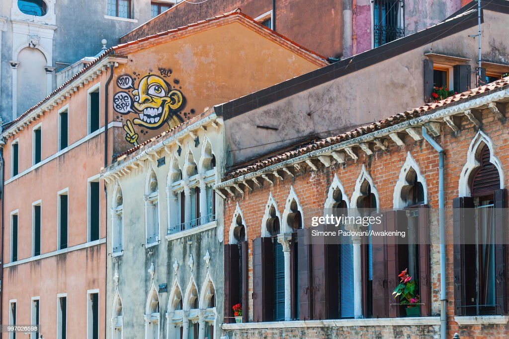 A graffiti is seen on a palace along the Cannaregio canal, on the way that connects railway station S. Lucia to Rialto bridge, through Cannaregio district, on July 12, 2018 in Venice, Italy. The plague of graffiti and tags on the walls of the palaces of Venice continues with new writing across the doors, windows and the plaster of shops, banks, historic buildings, ruining and attacking the priceless architectural heritage of the lagoon. Venice has been living with this problem for years, but it has not reached a resolution until today.
