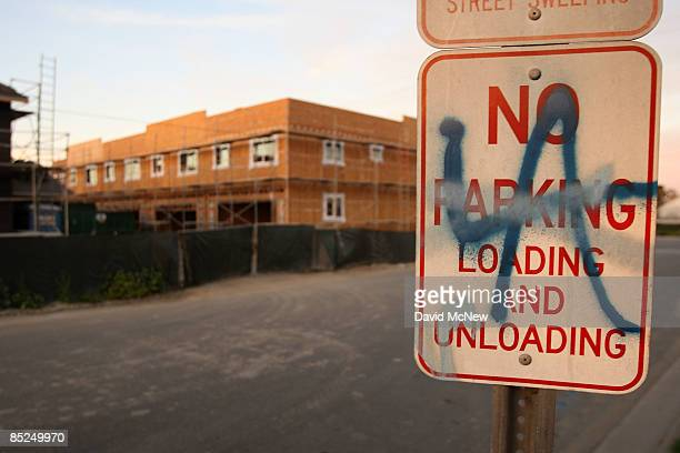 Graffiti is seen on a sign near a new townhouse construction site March 3, 2009 in Compton, California. The city that became known as the birthplace...