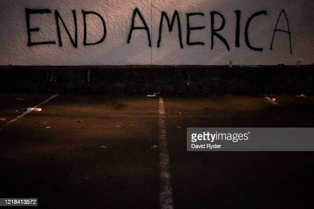 Graffiti is seen on a wall after demonstrators clashed with law enforcement near the Seattle Police Departments East Precinct shortly after midnight...