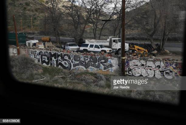 Graffiti is seen on the wall as Amtrak's California Zephyr passes through a city on its daily 2438mile trip to Emeryville/San Francisco from Chicago...
