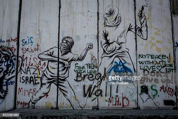 Graffiti is seen painted on the Palestinian side of the separation wall on January 18 2017 in Bethlehem West Bank 70 countries attended the recent...
