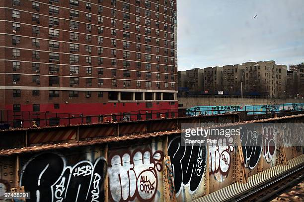 Graffiti lines the wall in front of buildings in the Harlem neighborhood on March 4 2010 in New York City Harlem the legendary epicenter of black...