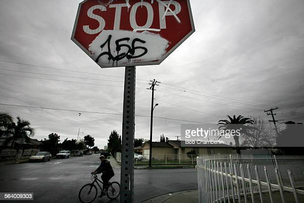 Graffiti marred stop sign at Nestor Ave and 154th Street in Compton on JANUARY 25 2013 Members of 155th Street Gang have been arrested for hate...