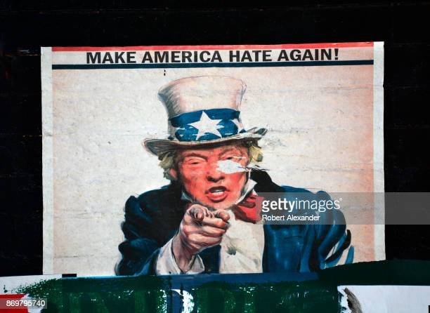 Graffiti mixed with an antiTrump poster and other ephemera affixed to a wall create a collaborative street art collage in the Chelsea district of New...