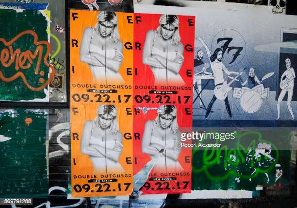 Graffiti mixed with posters and other ephemera create an outdoor collaborative street art collage in the Chelsea district of New York City