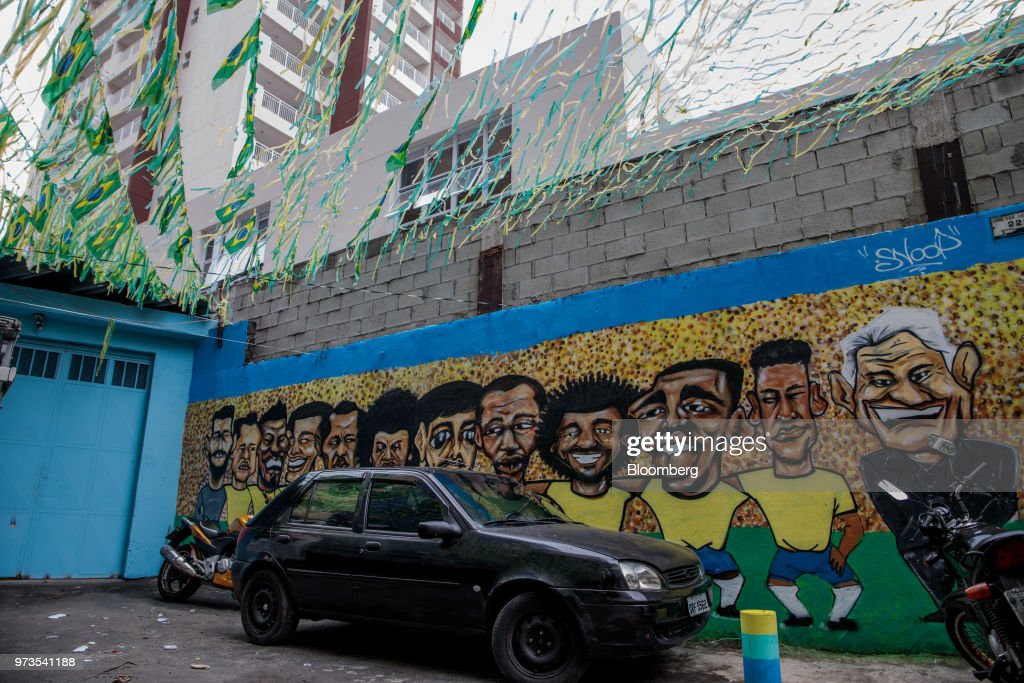 A graffiti mural displaying the Brazilian national team is seen ahead of the FIFA World Cup games in downtown Sao Paulo, Brazil, on Wednesday, June 13, 2018. In a curious quirk of Brazil's electoral calendar, for the last 28 years Latin America's largest economy has gone to the polls shortly after the World Cup. In the football-obsessed country, politicians have long attempted to hijack the sport to burnish their image. Photographer: Patricia Monteiro/Bloomberg via Getty Images