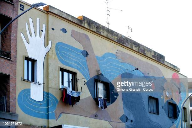 Graffiti mural in the Ostiense district titled 'Fish'n'kids by Agostino Iacurci on February 7 2019 in Rome Italy