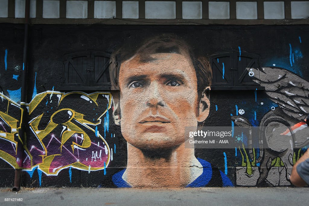 A graffiti mural of Inter Milan legend Giacinto Facchetti close to the stadium ahead of the final at Stadio Giuseppe Meazza on May 26, 2016 in Milan, Italy.