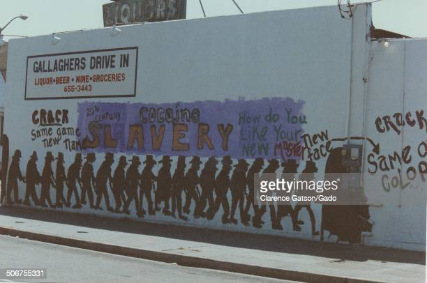 A graffiti mural protesting crack cocaine at Gallaghers Drive In San Francisco California 1990 Mural reads Cocaine Slavery and Crack Same Game New...