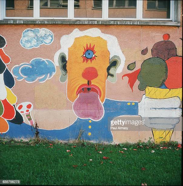 Graffiti of a one eyed man holding an ice cream cone L'Universite d'Orsay France 1973