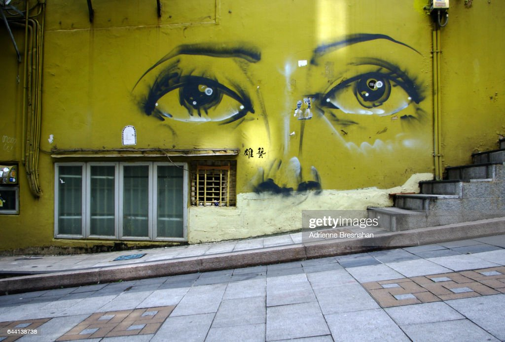 Graffiti of a Woman's Eyes Near Upper Lascar Road, Hong Kong : Stock Photo