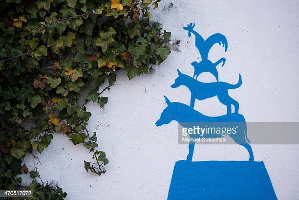 Graffiti of Bremen Town Musicians next to an ivy plant on April 15 2015 in Bremen Germany