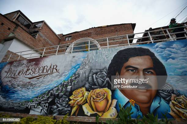 A graffiti of late Colombian drug lord Pablo Escobar at the neighborhood that has his name in Medellin Colombia on September 8 2017 / AFP PHOTO /...