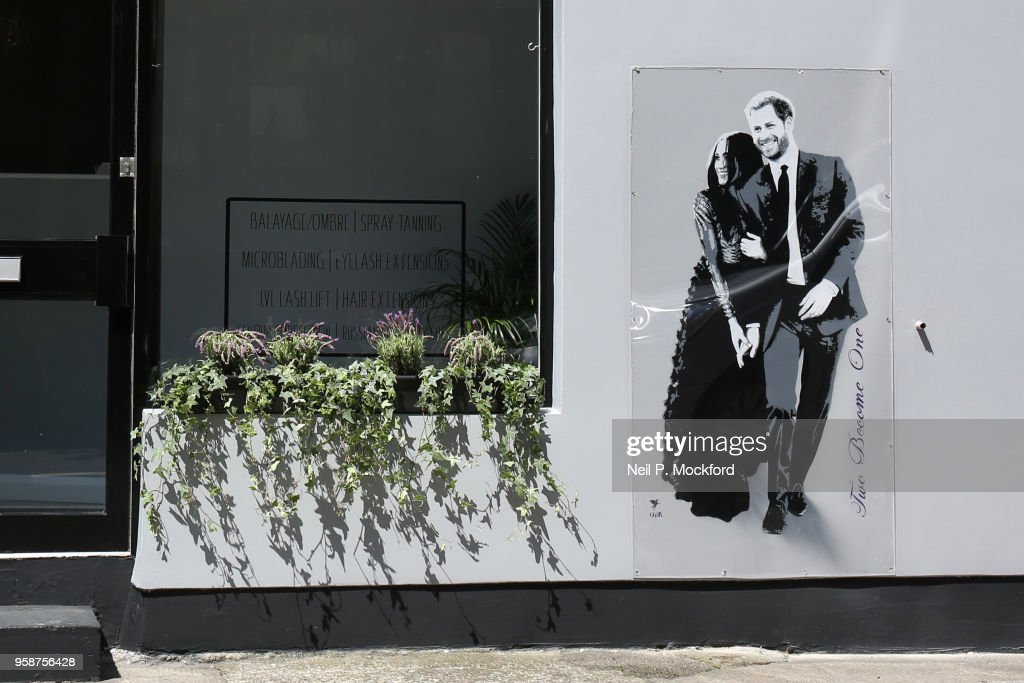 Graffiti of Prince Harry and Ms. Meghan Markle by street artist Pegasus on the wall of hair & beauty salon The N7 Collective on May 15, 2018 in London, England. The couple will marry in St. George's Chapel at Windsor Castle on May 19.