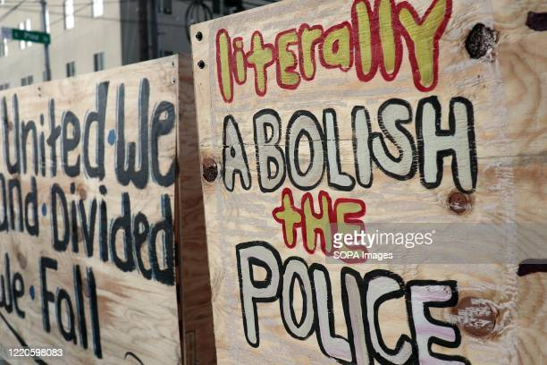 """Graffiti on a barricade inside the so-called """"Capitol Hill Autonomous Zone"""" call for the abolition of police. The area surrounding Seattle's East..."""