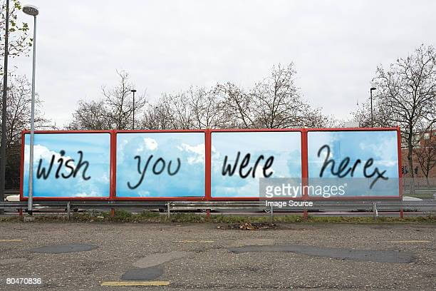 graffiti on a billboard - irony stock pictures, royalty-free photos & images