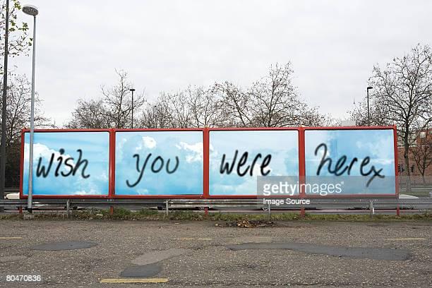 graffiti on a billboard - irony stockfoto's en -beelden