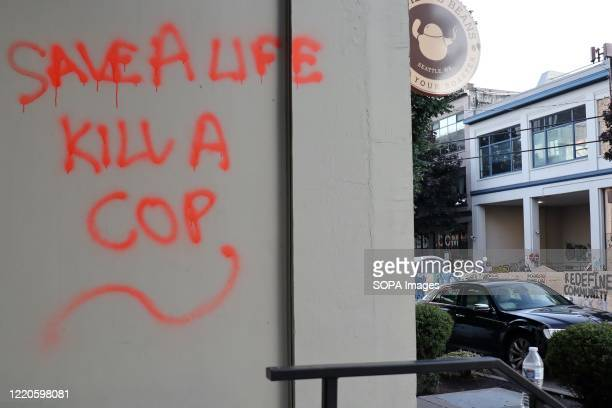 Graffiti on a building inside the socalled Capitol Hill Autonomous Zone in Seattle The area surrounding Seattle's East Precinct police station which...