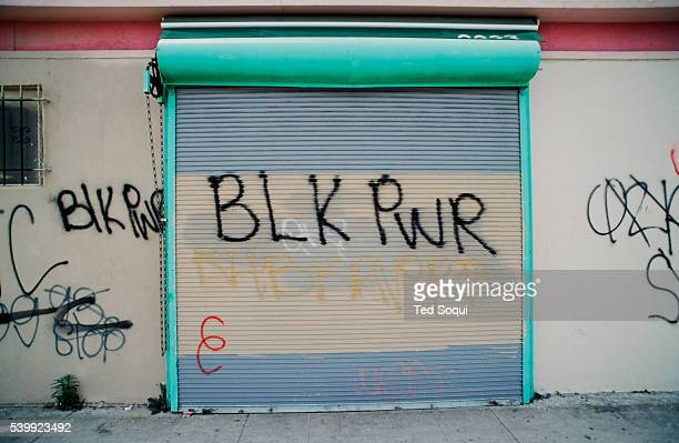 Graffiti on a business in South Central Los Angeles. Los Angeles has undergone several days of rioting due to the acquittal of the LAPD officers who...