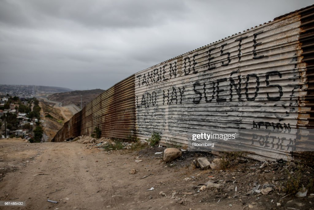 Graffiti on a section of a U.S.-Mexico border wall reads 'On this side there are dreams too' in Tijuana, Mexico, on Monday, May 21, 2018. 'We won't care about threats of a wall,' National Regeneration Movement Presidential candidate Andres Manuel Lopez Obrador announced, assuring another rally crowd in Zacatecas, one of the states that sends the most migrants to the U.S., that with him in power, they'll achieve equal footing with their neighbors to the north. Photographer: Alejandro Cegarra/Bloomberg via Getty Images