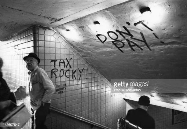 Graffiti on a subway stairwell reads 'Don't Pay' and 'Tax Rocky' New York New York January 6 1970