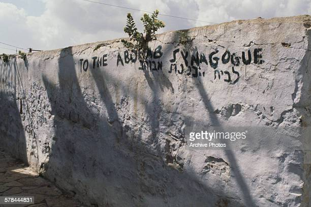 Graffiti on a wall in Safed Israel pointing to the Abuhav synagogue circa 1970
