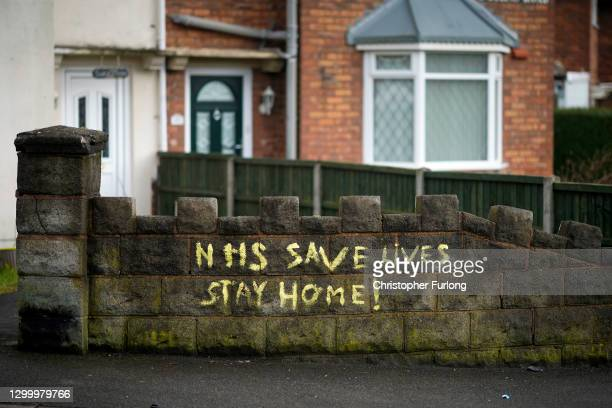 Graffiti on a wall in the WS2 postcode area declares 'NHS SAVE LIVES STAY HOME! as local authorities prepare to deploy covid-19 testing in an effort...