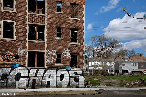 Graffiti on deserted buildings on Grand River Detroit Known as the world's traditional automotive center Detroit is a metonym for the American...