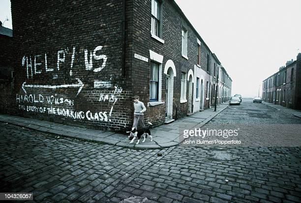 Graffiti on Peabody Street in Bolton Greater Manchester England in 1976 It reads 'Help Us Harold Wilson the enemy of the working class'