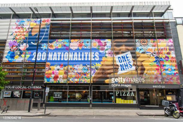 Graffiti on side of the Rich Mix cinema and Community arts hub in Shoreditch, London showing support for the NHS & diversity with over 200...