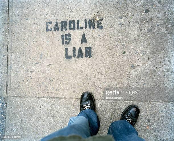 graffiti on sidewalk - sidewalk stock pictures, royalty-free photos & images