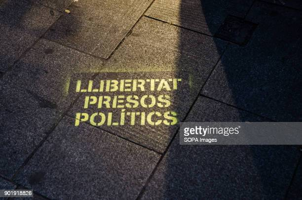 Graffiti on the urban land with the text 'Freedom political prisoners' Since 2nd December 2013 when the catalan Government chaired by Artur Mas carry...