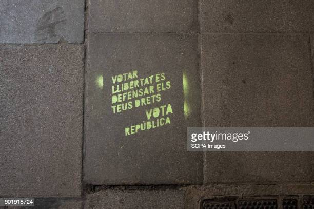Graffiti on the urban land with the text 'To vote freedom is to defend your rights Vote Republic'Since 2 December 2013 when the catalan Government...