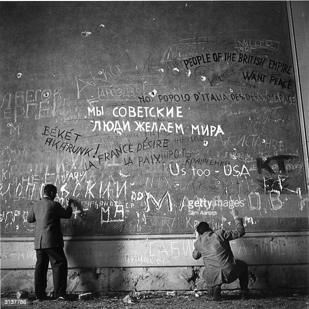 Graffiti on the wall of Hitler's chancellery shortly after his death The men are Life photographers Hank Walker and Charles Steinhern