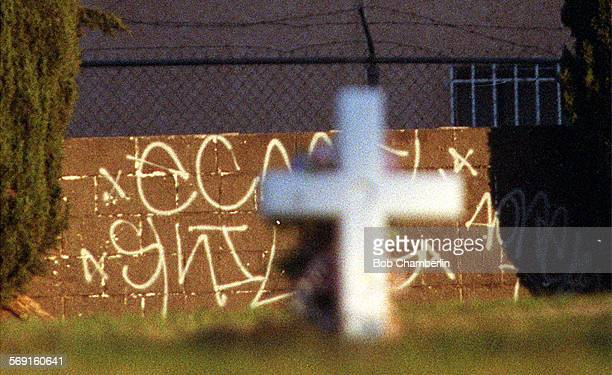 Graffiti on wall in graveyard at Angeles Abbey Memorial Park in Compton on A spectacular cemetery with a central building designed as copy of the Taj...