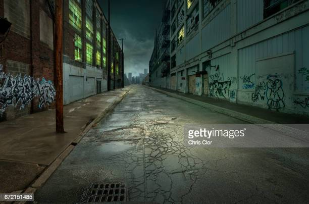 graffiti on walls on empty city street - abandoned stock pictures, royalty-free photos & images