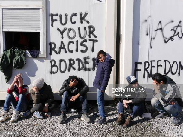A graffiti read 'Fuck Your Racist Border' seen at the refugee camp Approximately 14 000 people were left in uncertainty in the makeshift camp in...