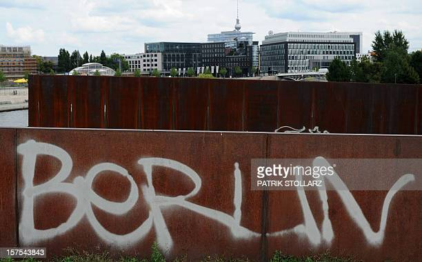 A graffiti reading 'Berlin' has been sprayed on a metal sheet near the main station and with the TV tower in the background on July 27 2011 in Berlin...