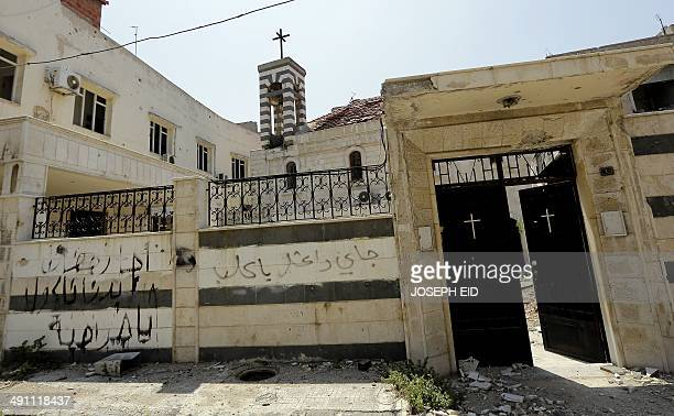 'Hey thieves we want to eat' 'Beware you dogs ISIL is coming ' which was sprayed by opposition fighters is seen on the external wall of the church of...