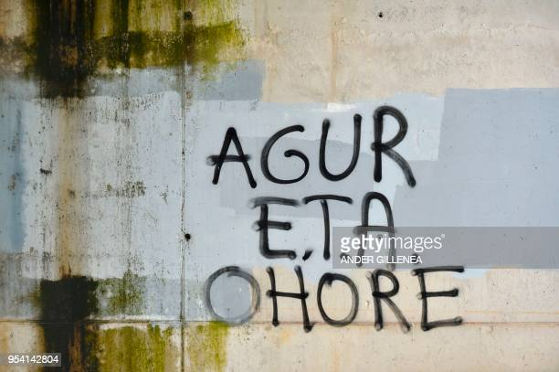 A graffiti reading in Basque ETA Farewell and may you go with honor is pictured in the Spanish Basque village of Agurain on May 3 2018 Spanish Prime...