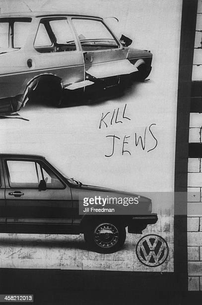Graffiti reading 'Kill Jews' written on a Volkswagen advert in a tunnel on the London Underground London 1982