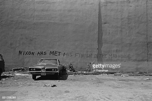 Graffiti reading 'Nixon has met his finish in the mad house' New York City circa 1976