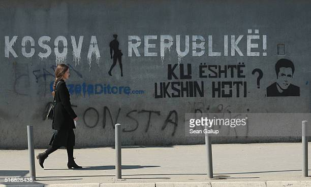 Graffiti reads 'The Kosovo Rebublic' and 'Where is Ukshin Hoti' on a wall at the Kosovo Assembly on March 20 2016 in Pristina Kosovo Kosovo following...