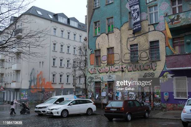 Graffiti reads We are not for sale on the side of a leftist squat at the corner of Rigaer Strasse and Liebigstrasse in Friedrichshain district on...
