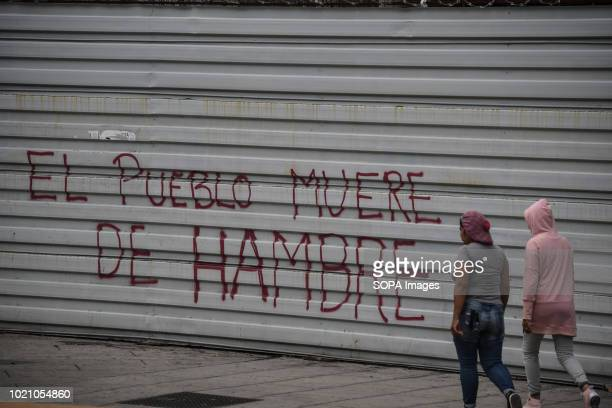 A graffiti saying Hunger is seen in the streets of Caracas The opposition called for a general strike for one day as a protest against the new...