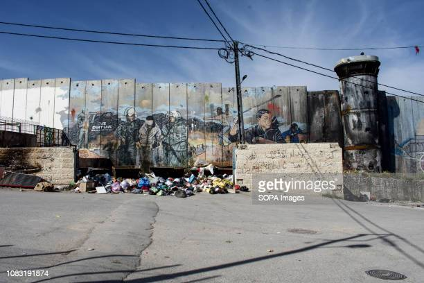 Graffiti seen on the Israeli West Bank barrier in Dheisheh Refugee Camp The Israeli Separation Wall is a dividing barrier that separates the West...