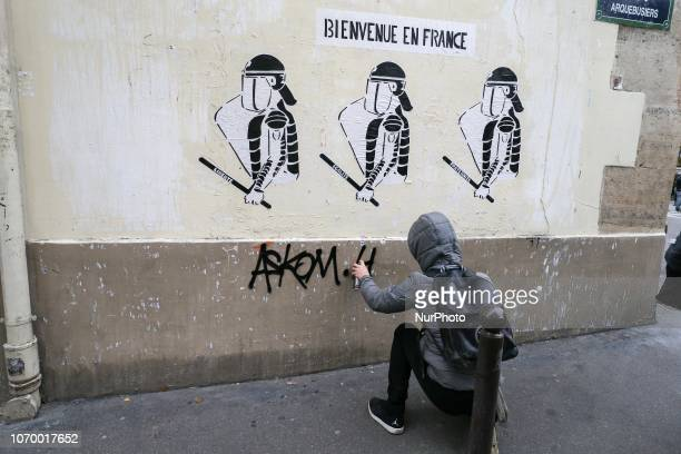 A graffiti shows riot policemen and reads « welcome to France » during a demonstration against rising costs of living in place de la Bastille in...