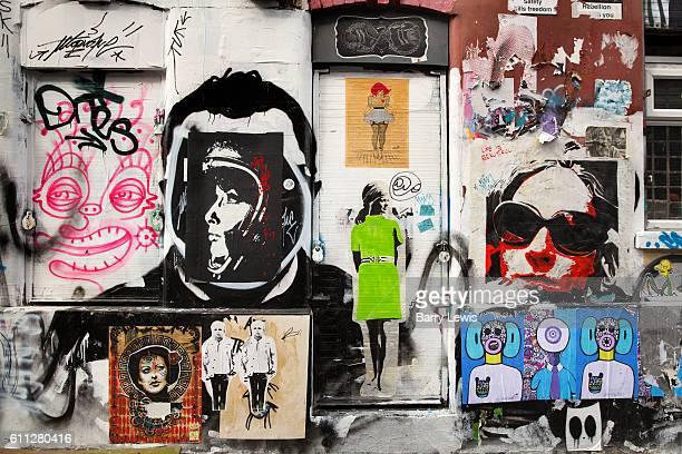 Graffiti stencil art cover a building on Brick Lane East London