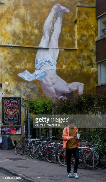 Graffiti street art is pictured on the side of a building in Bristol south west England on May 8 2019 Five years ago British street artist Banksy...